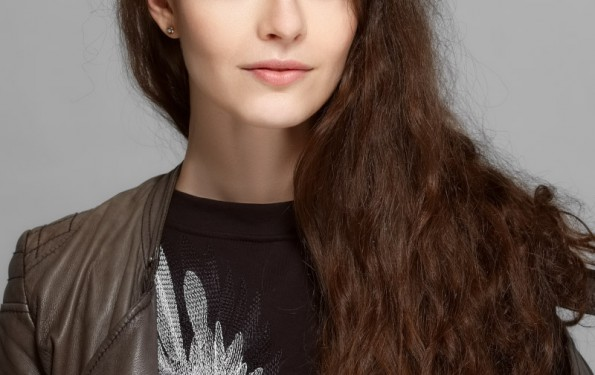 portrait of pretty girl with perfect clean skin and natural makeup. long dark hair.